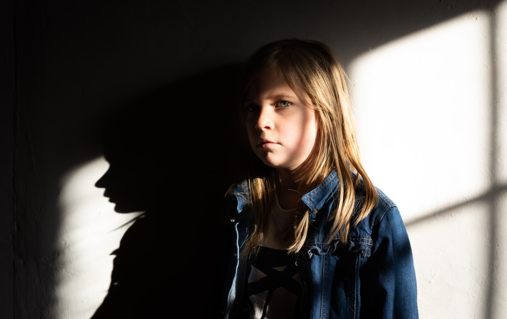 girl standing against the wall