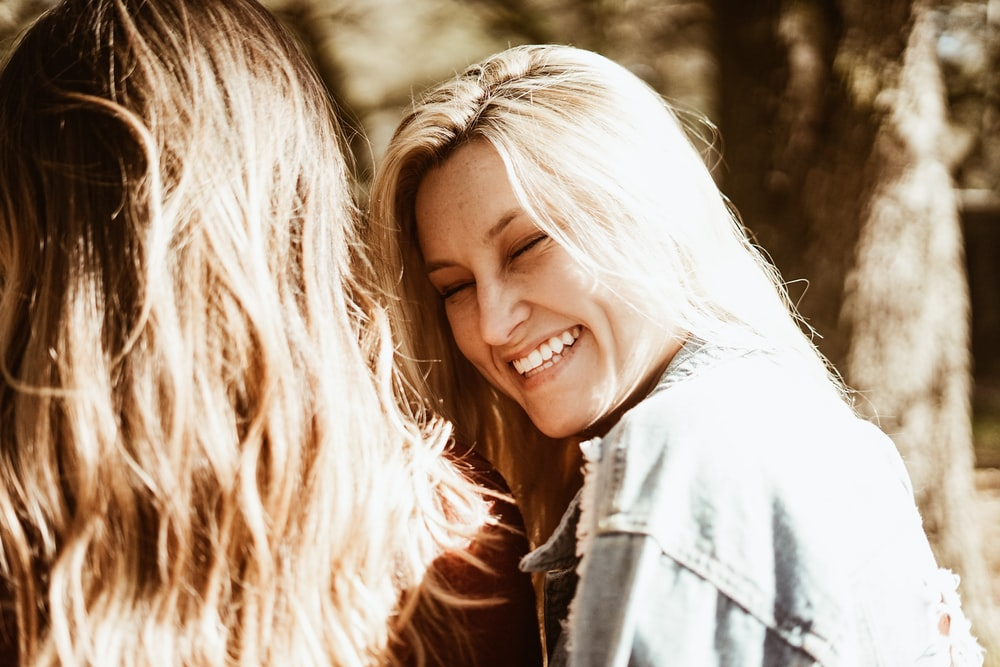 smiling woman wearing blue denim jeans