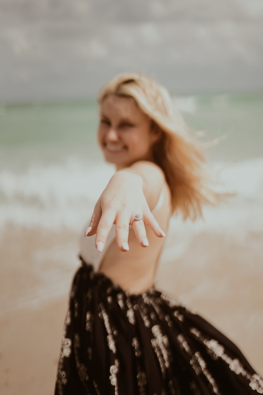woman showing silver-colored ring