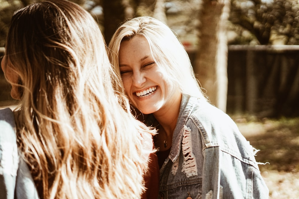 smiling girl wearing blue denim jacket outdoor