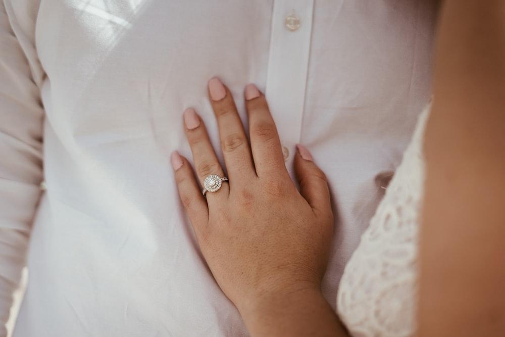 woman touching white dress shirt