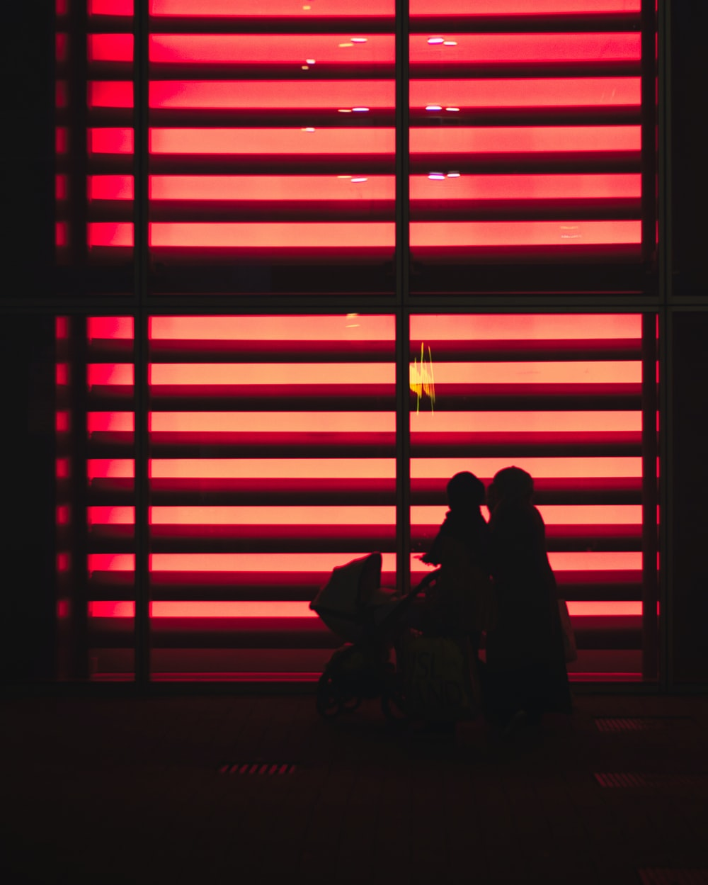 red lighted window blinds