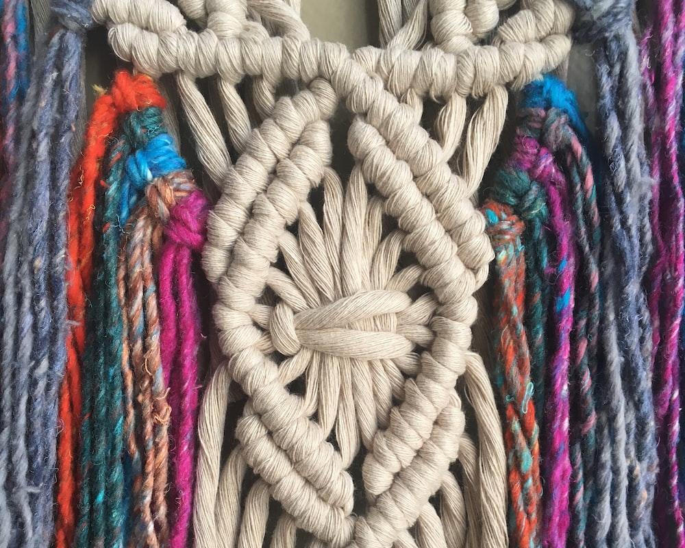 white and multicolored textiles