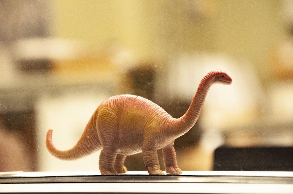 dinosaur toy on white desk