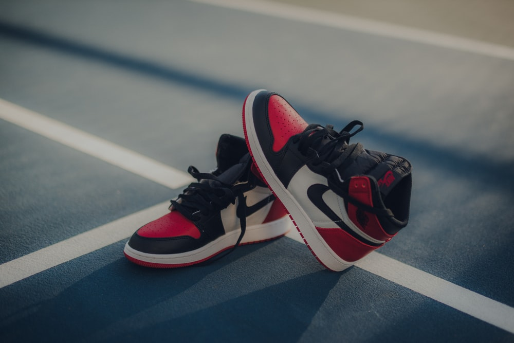 pair of black-white-and-red Air Jordan 1 shoes