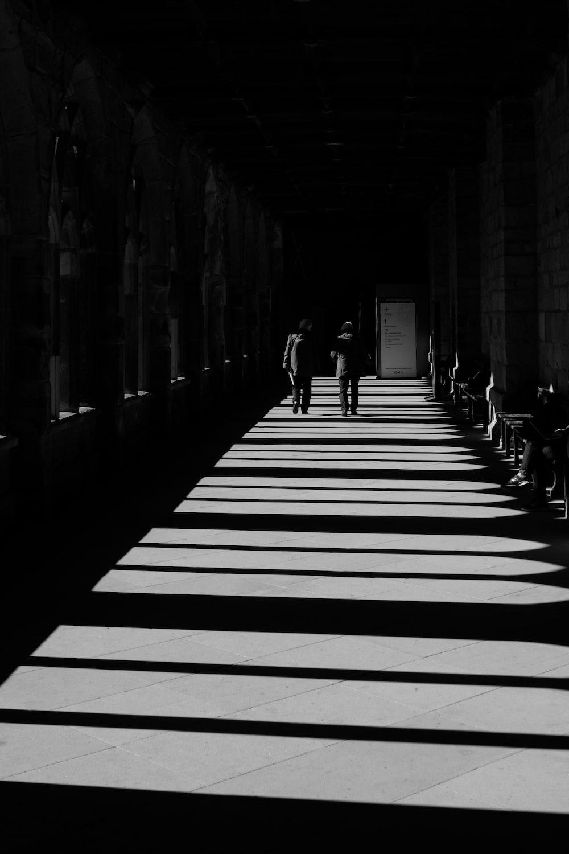 two men walking in a corridor