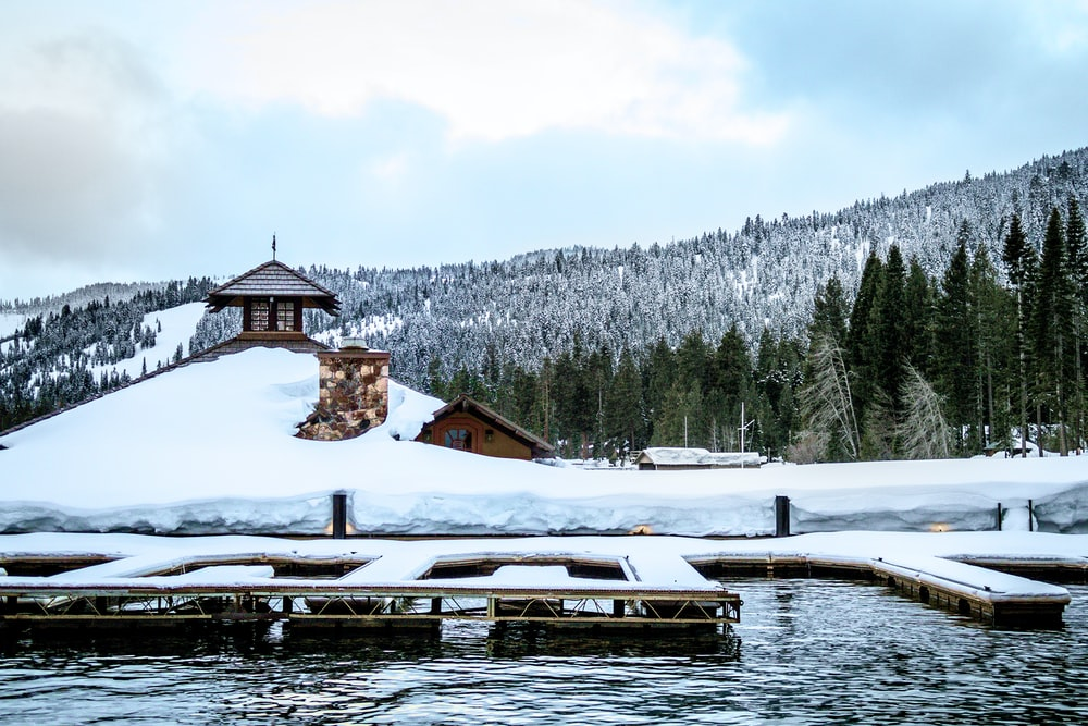 snow covered dock on the water