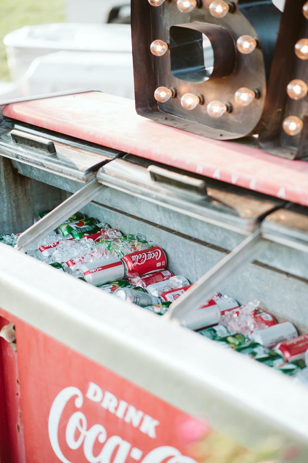 white and red Coca-Cola deep freezer