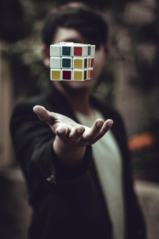 Rubik's cube floating on man's palm