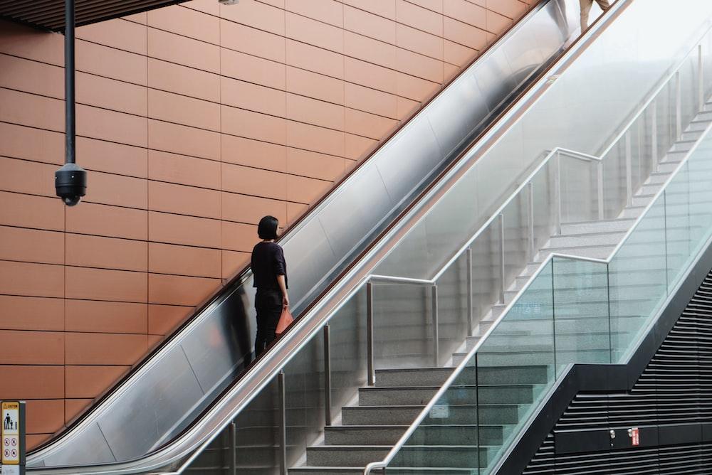 woman on an escalator going up