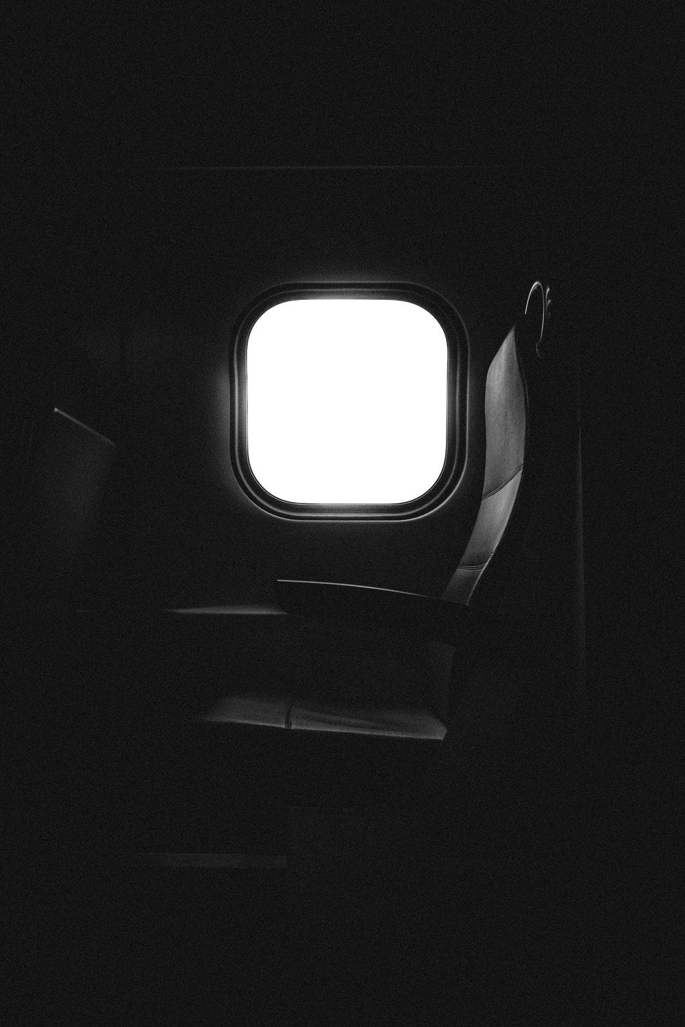 window of an airplane with a seat