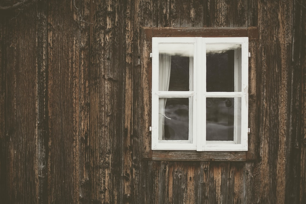white wooden clear glass window sash