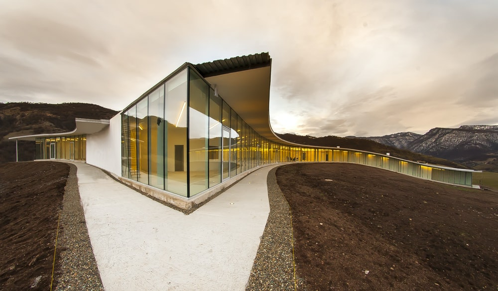 clear glass panel building under cloudy during daytime
