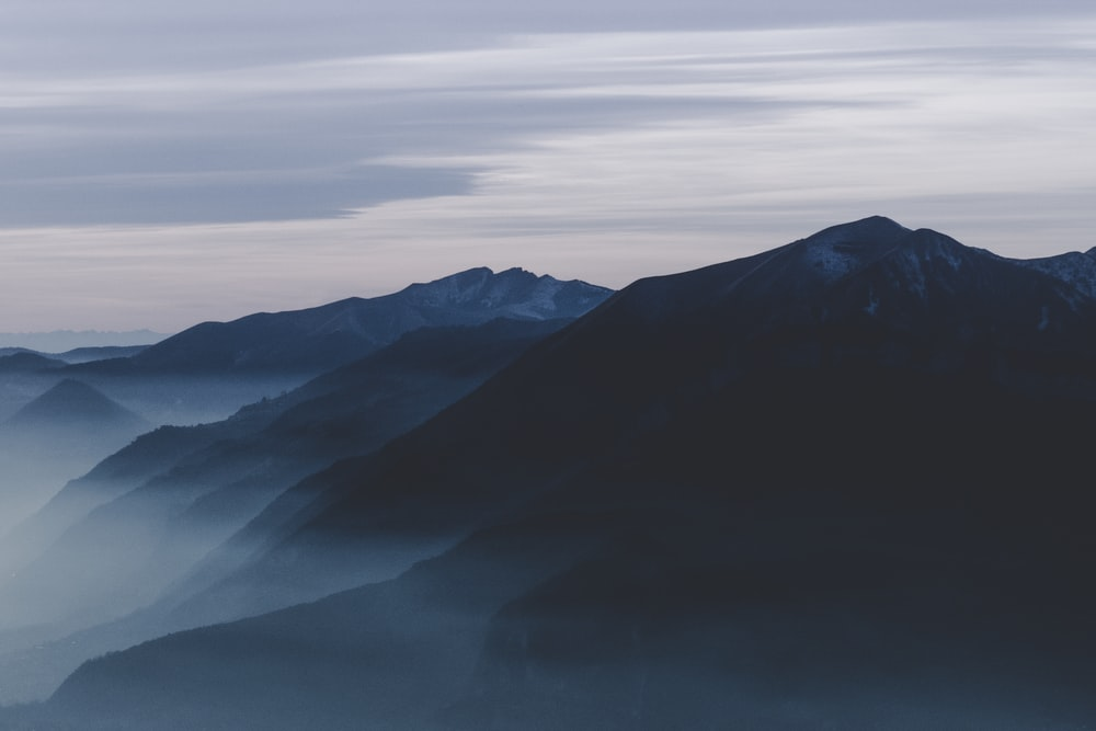 silhouette of mountain ranges during daytime
