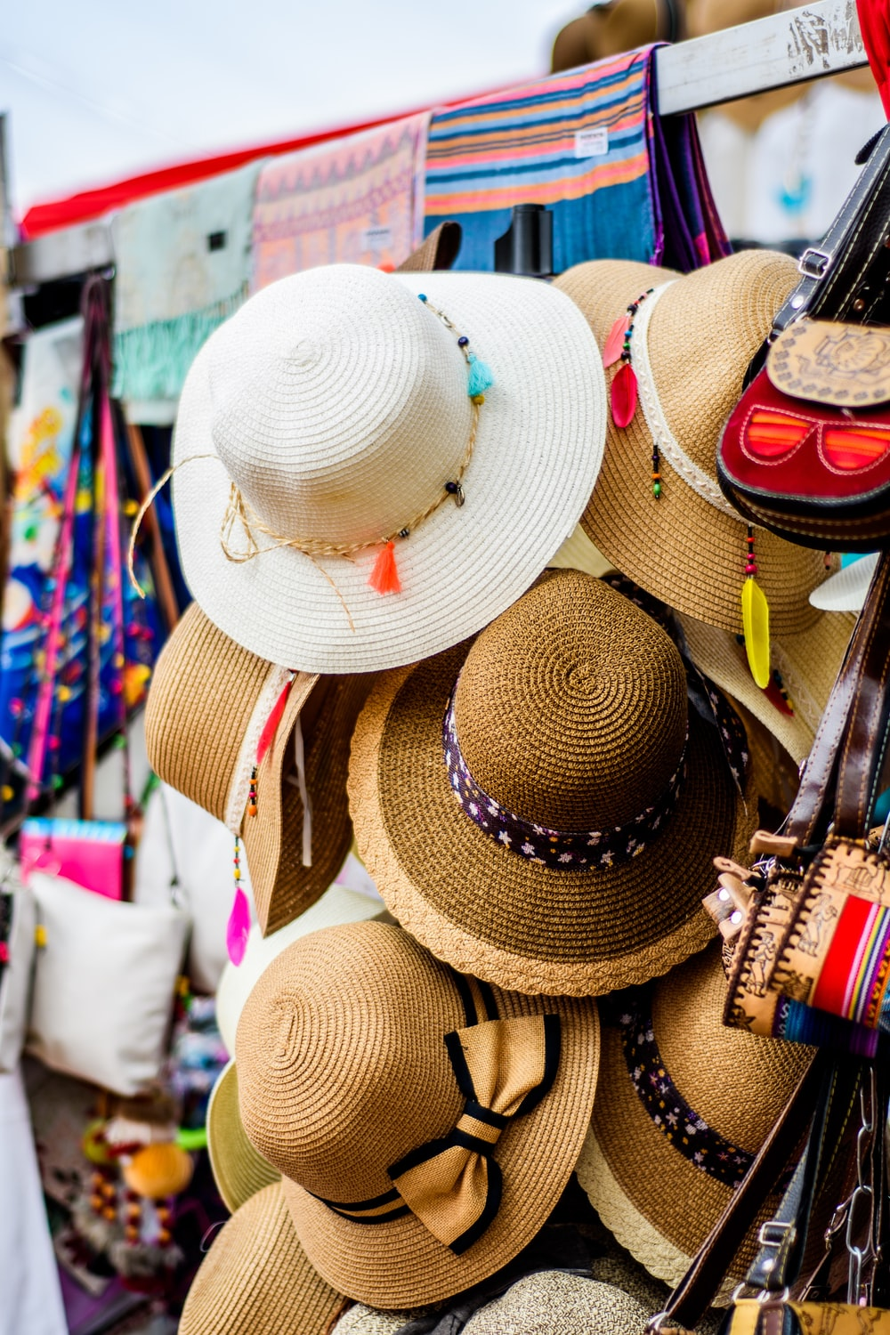 assorted brown and white sun hat display during daytime