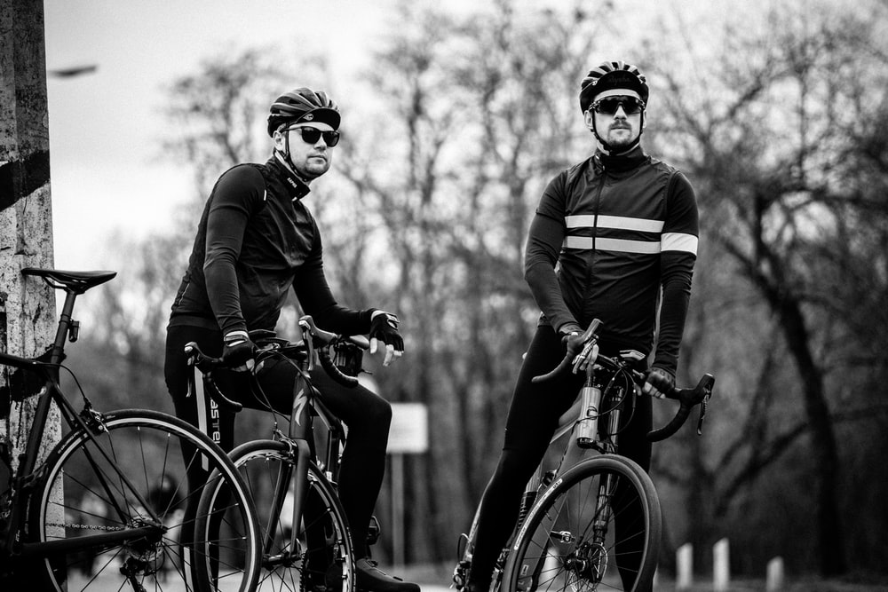 grayscale photography of two cyclers