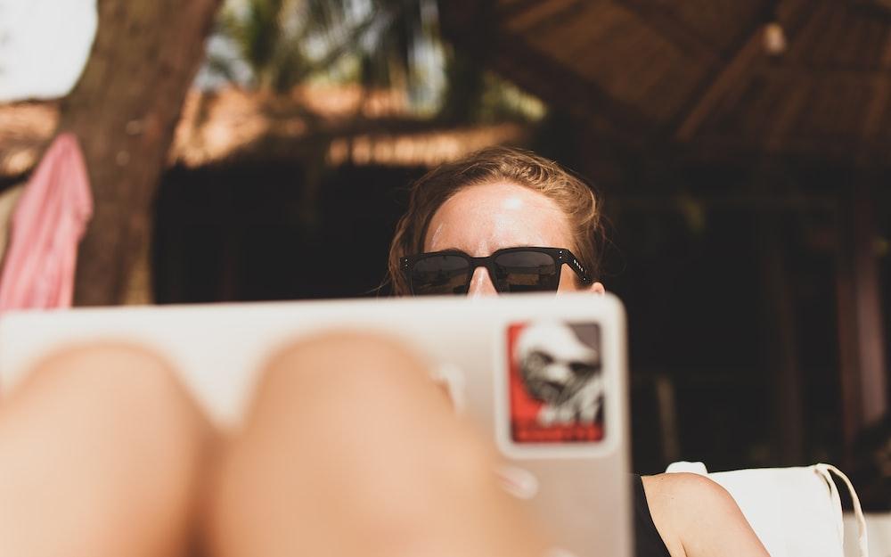 woman wearing black framed sunglasses