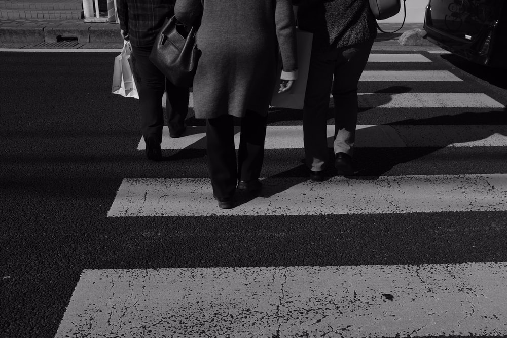 three person on pedestrian lane