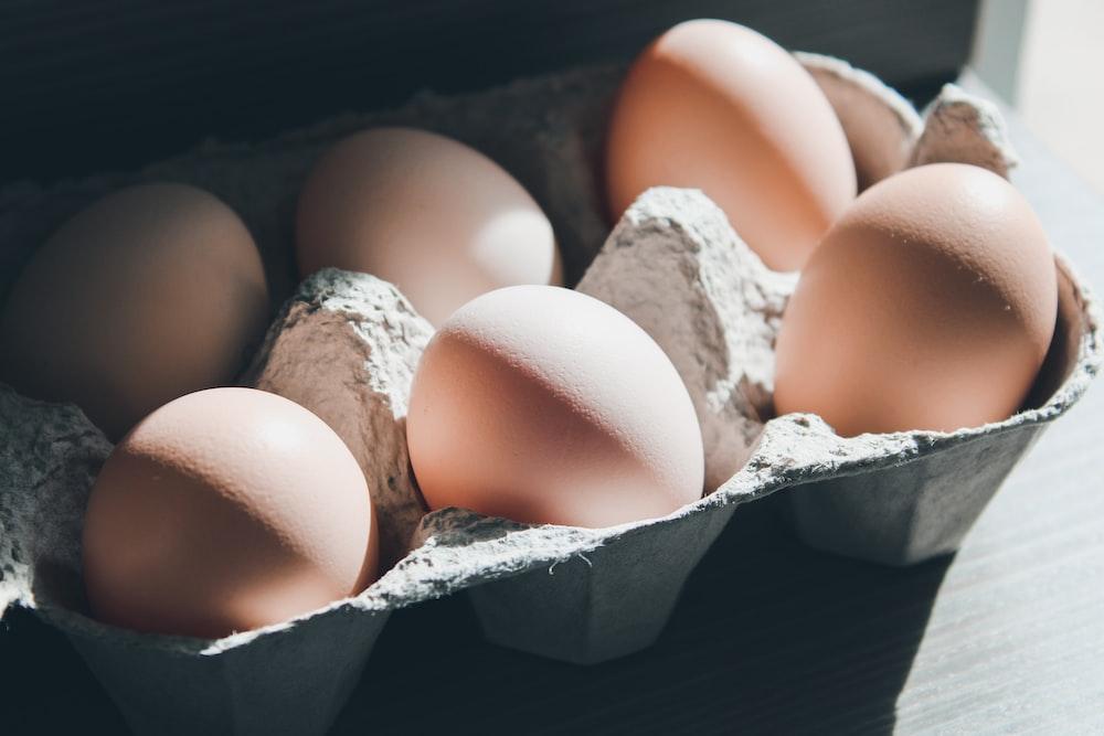 six eggs on tray