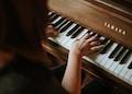 woman playing Yamaha piano