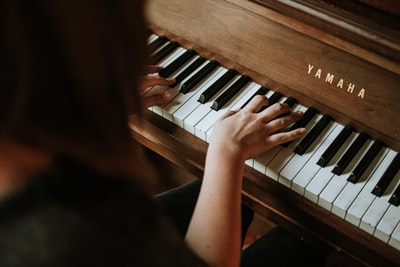 woman playing yamaha piano piano zoom background