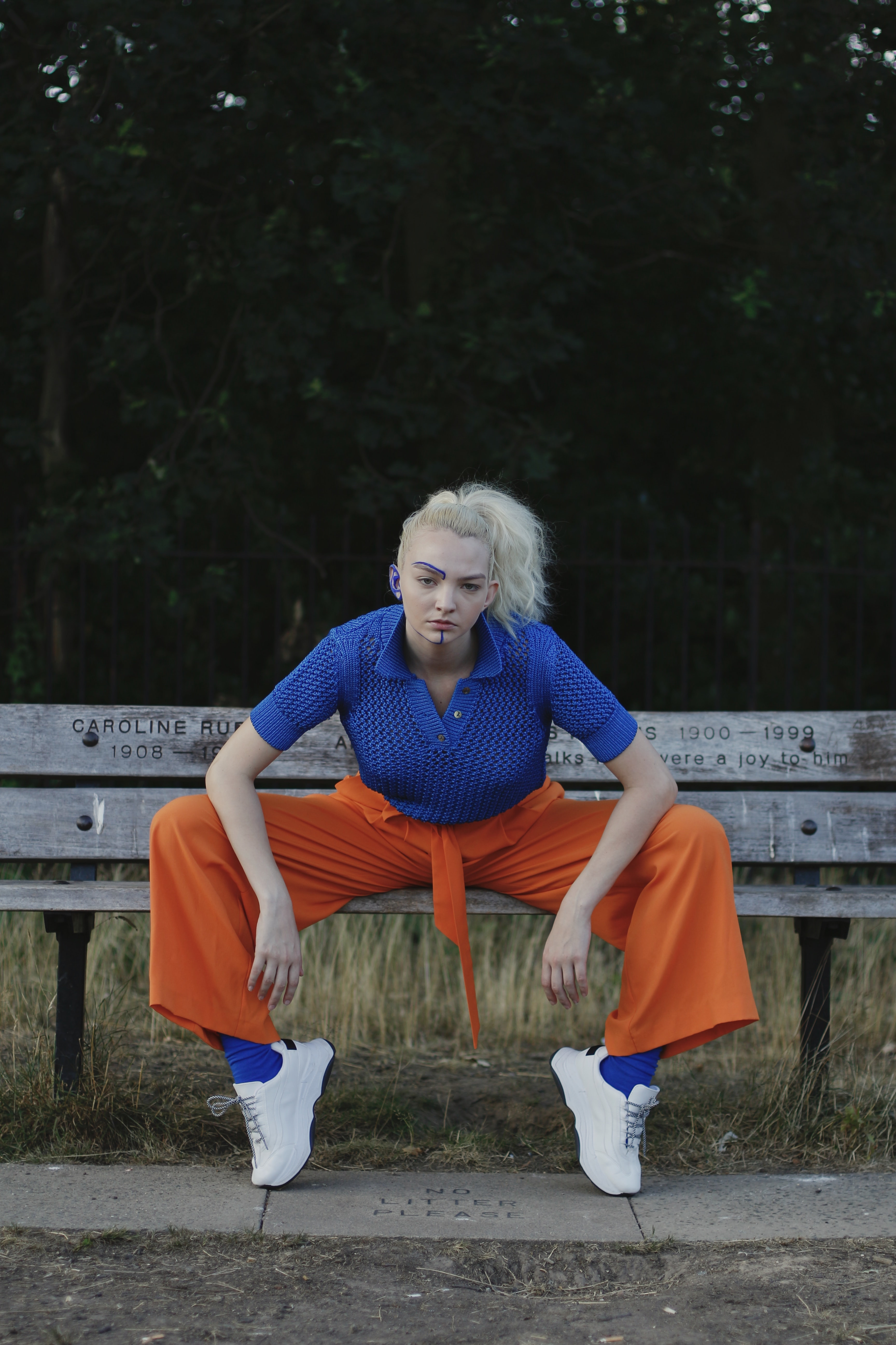woman sits and wide open her legs