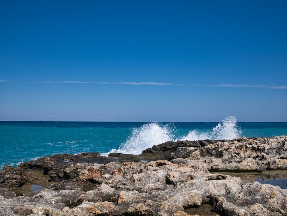 waves splashing on rocks by the seashore