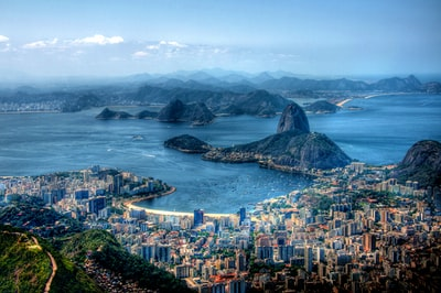 aerial photography on city near body of water rio de janeiro teams background