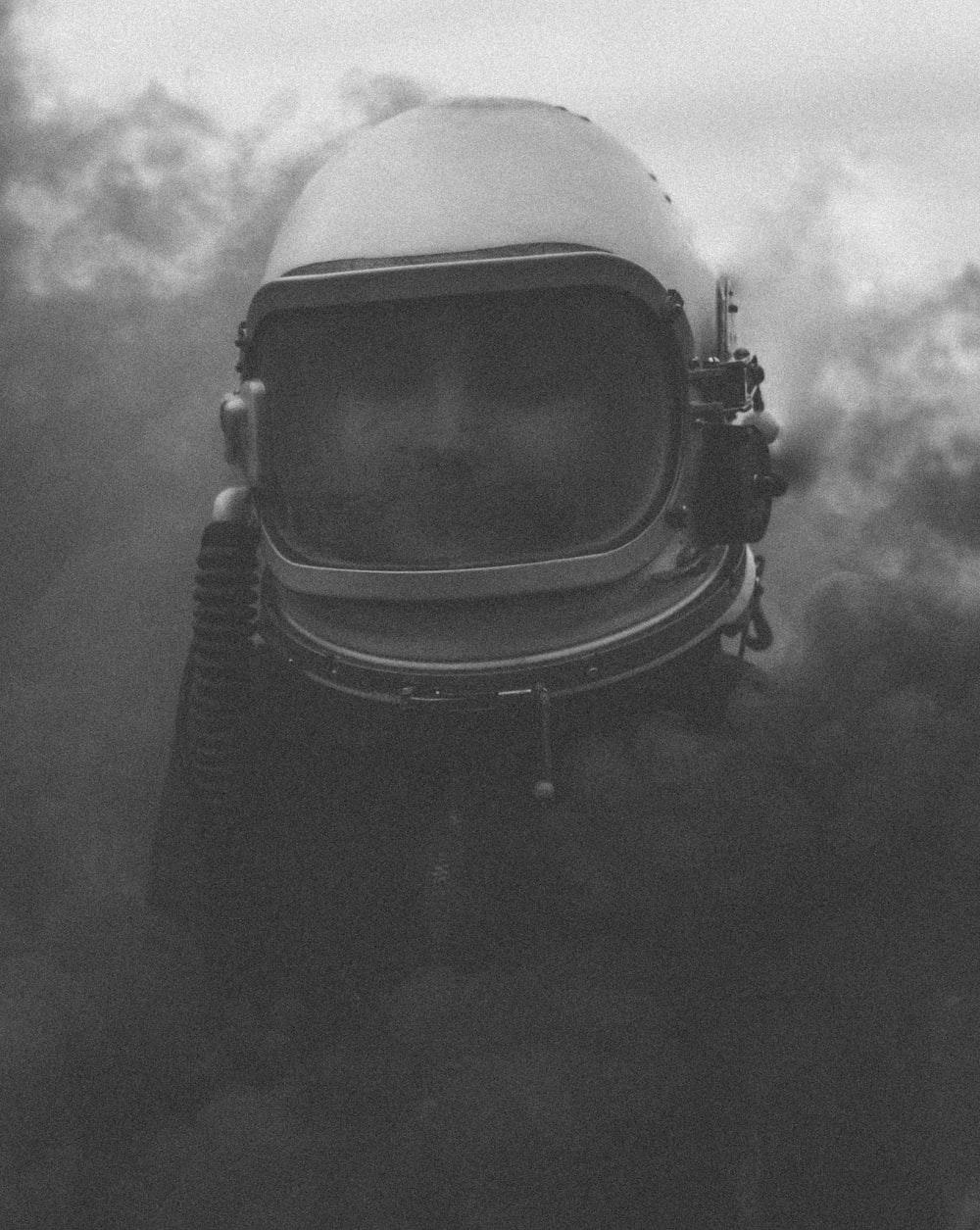 grayscale photo of person wearing vintage scuba helmet