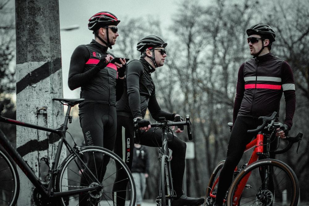 3 men on bikes talking
