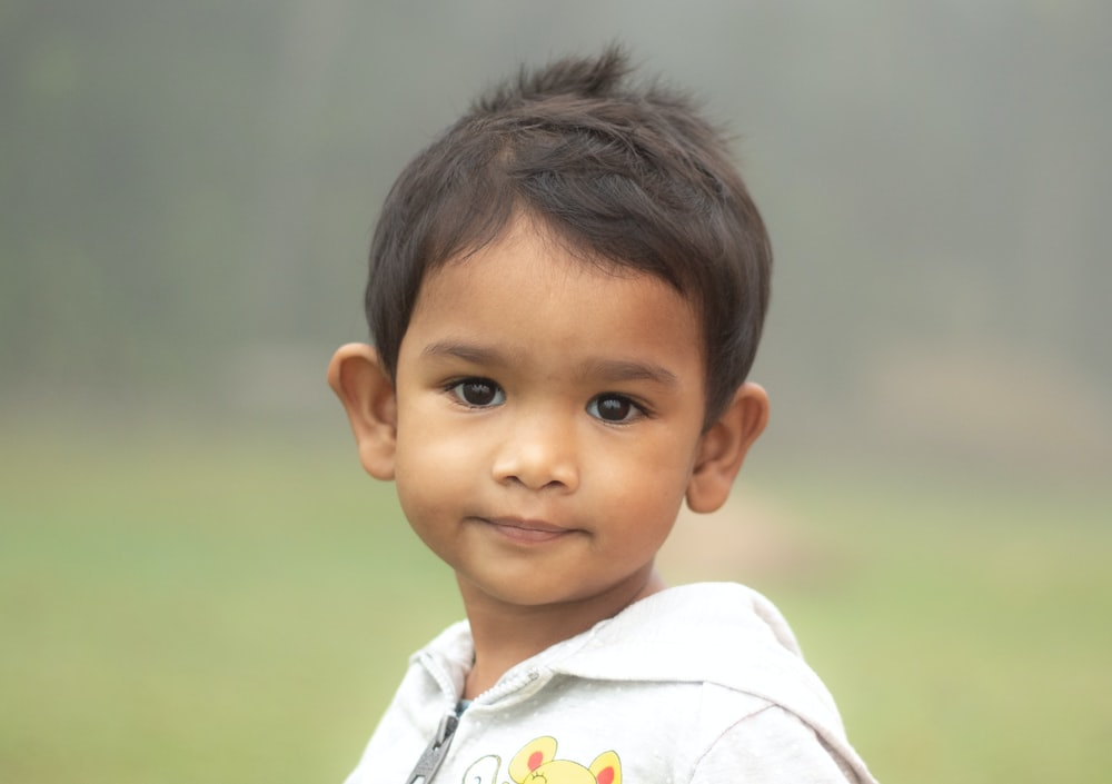 portrait of boy wearing white hoodie top