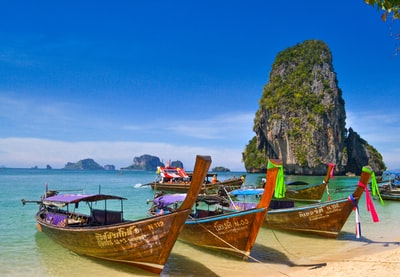 five brown wooden boats thailand teams background