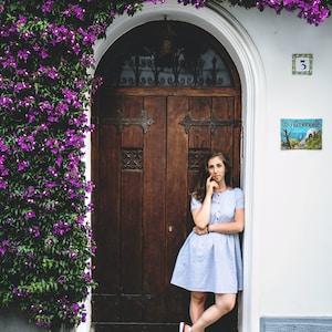 woman standing near closed door