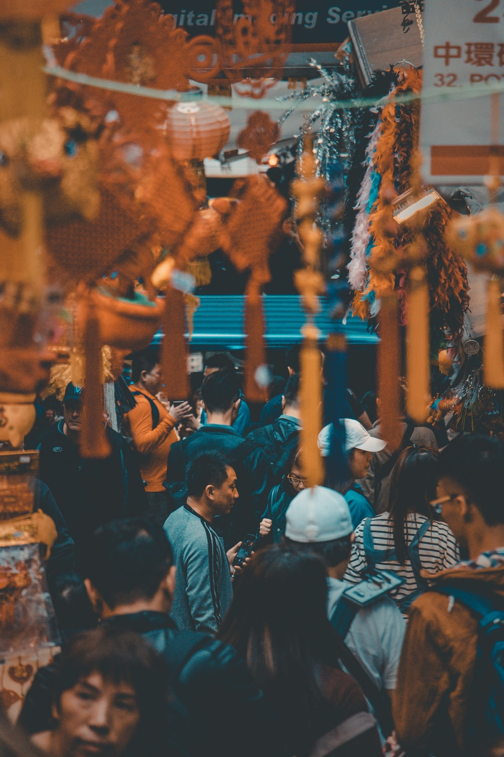 selective focus photography of people along night market