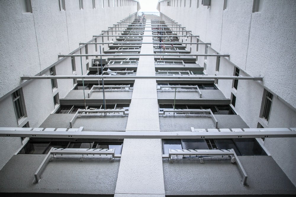 low-angle photography of concrete high rise building