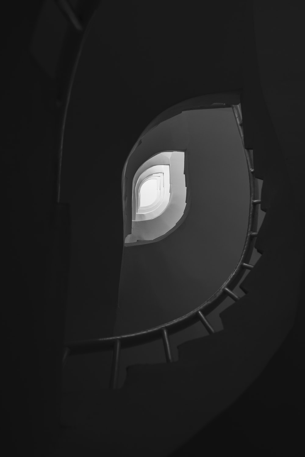 light on top of spiral staircase