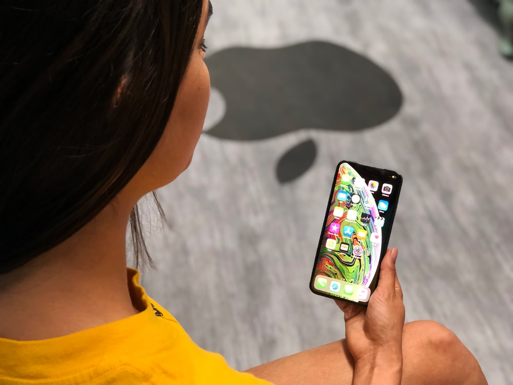 person holding black iPhone XS Max