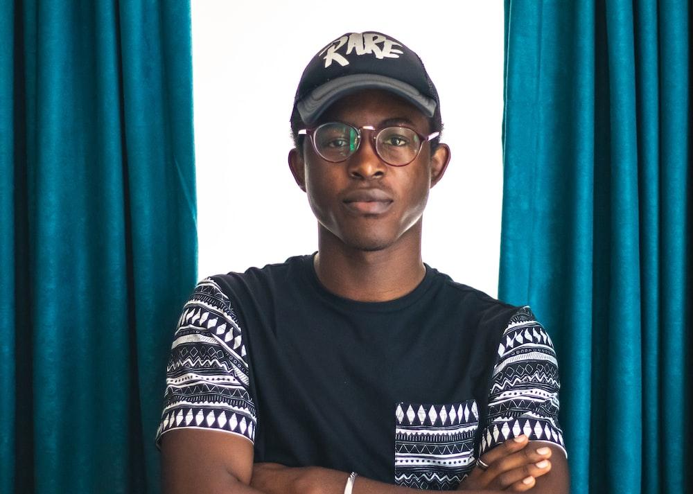 man wearing black Rare-printed cap