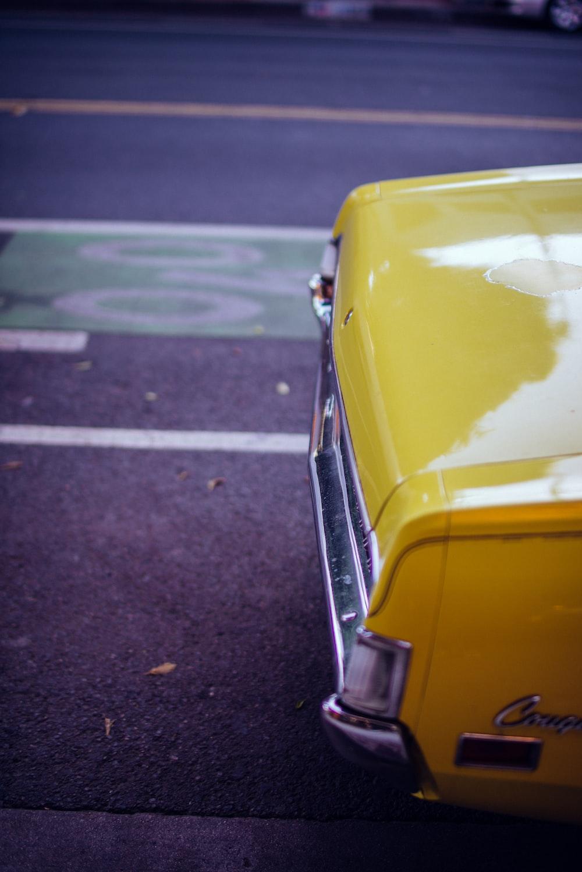 yellow car on road