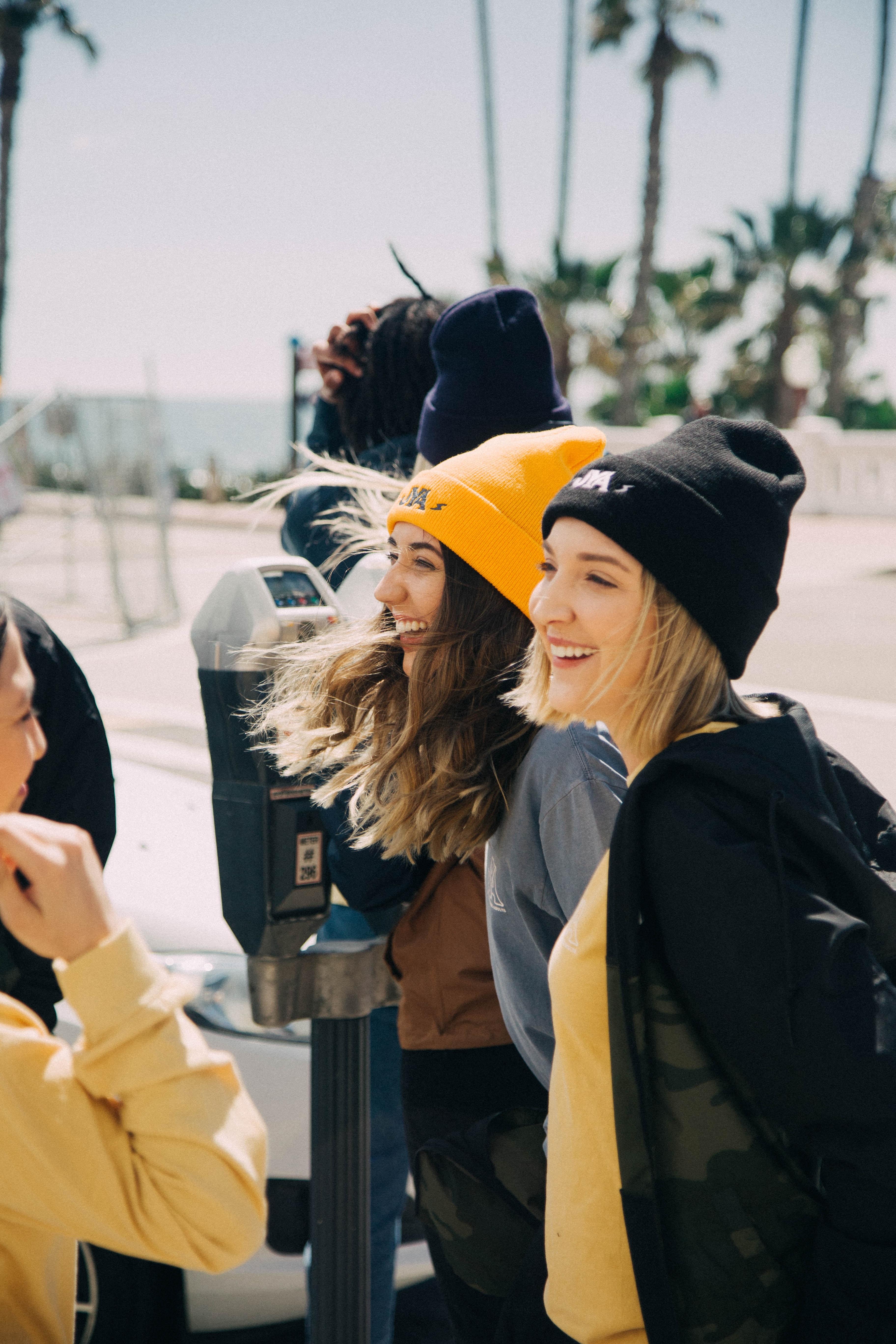 women laughing during daytime