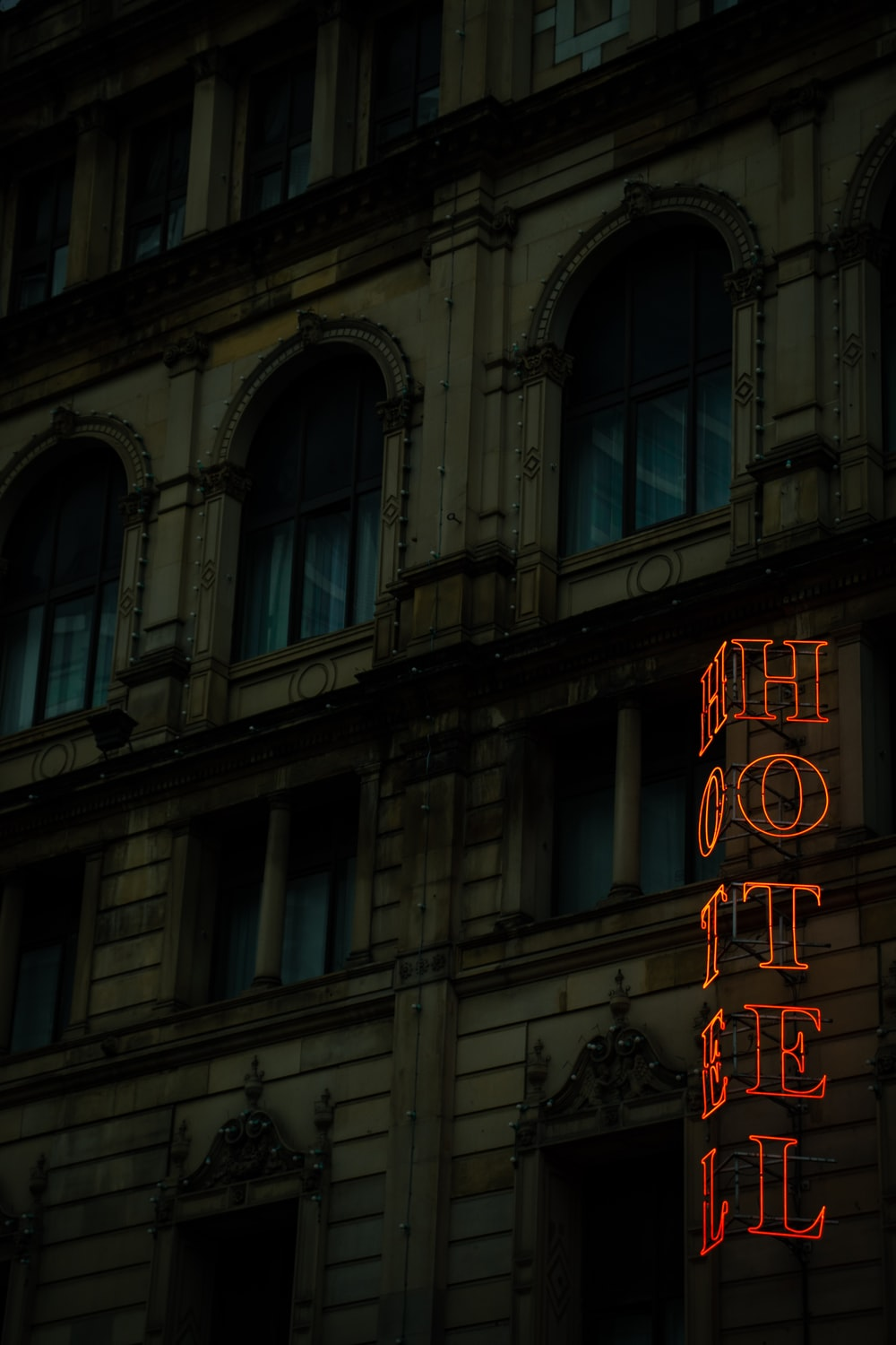 building with hotel light signage