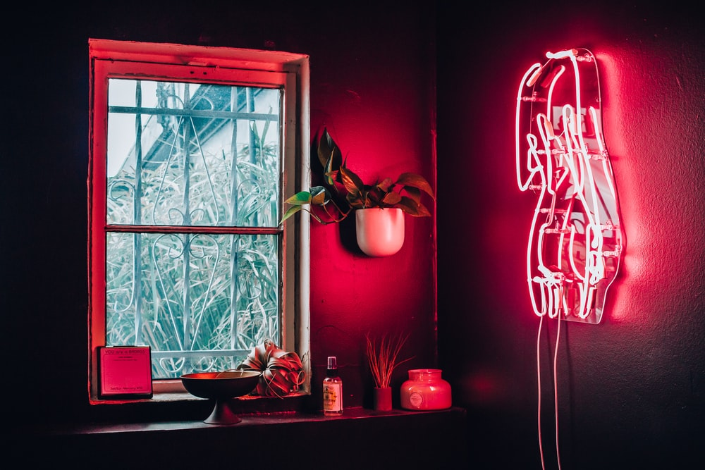 pink neon signage on wall turned-on