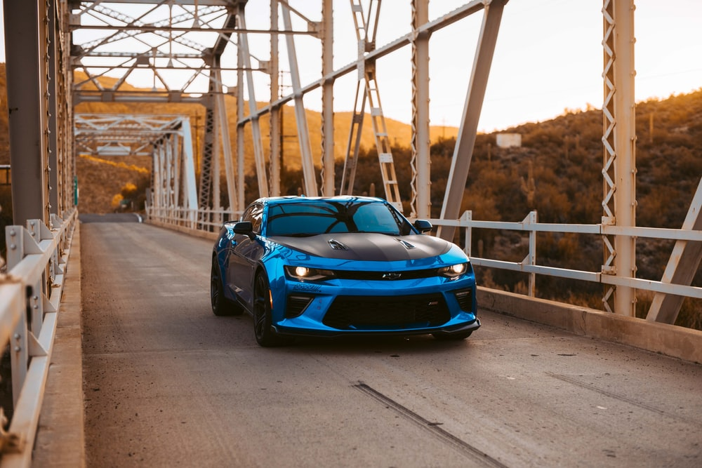black and blue Chevrolet vehicle on bridge