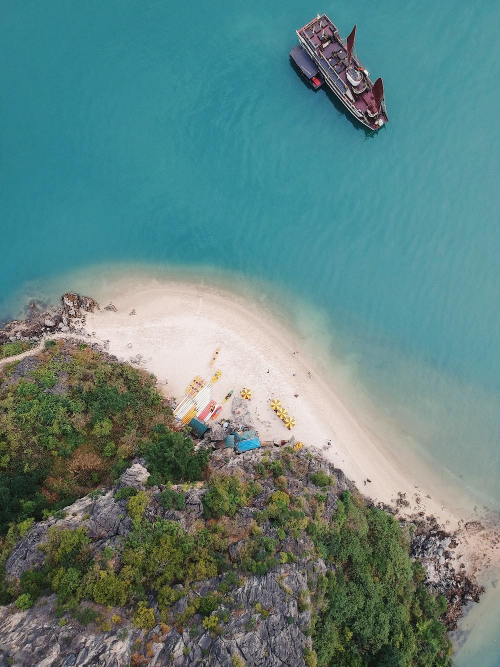 boat near seashore in aerial photography