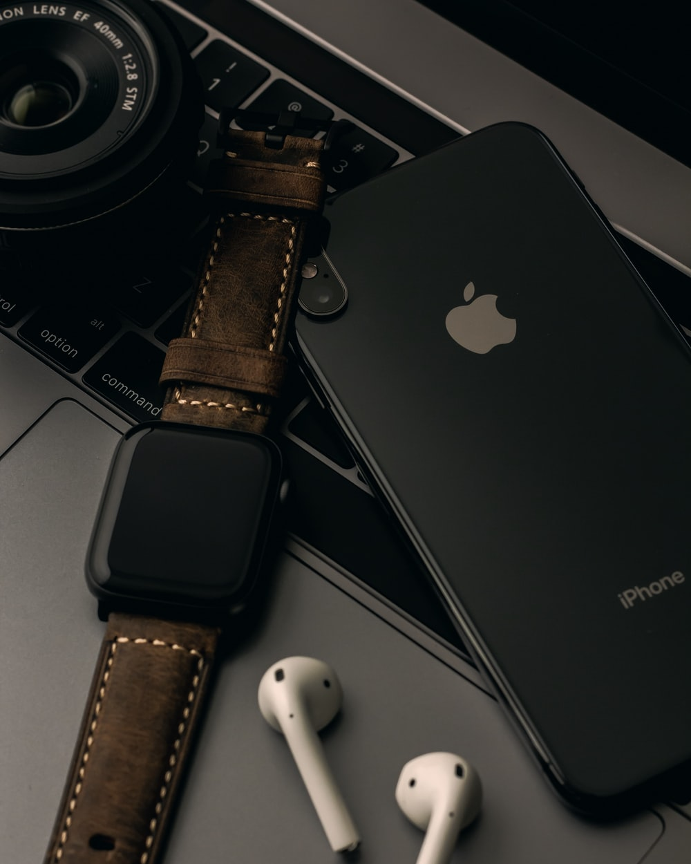 iPhone X beside Apple Watch and AirPods