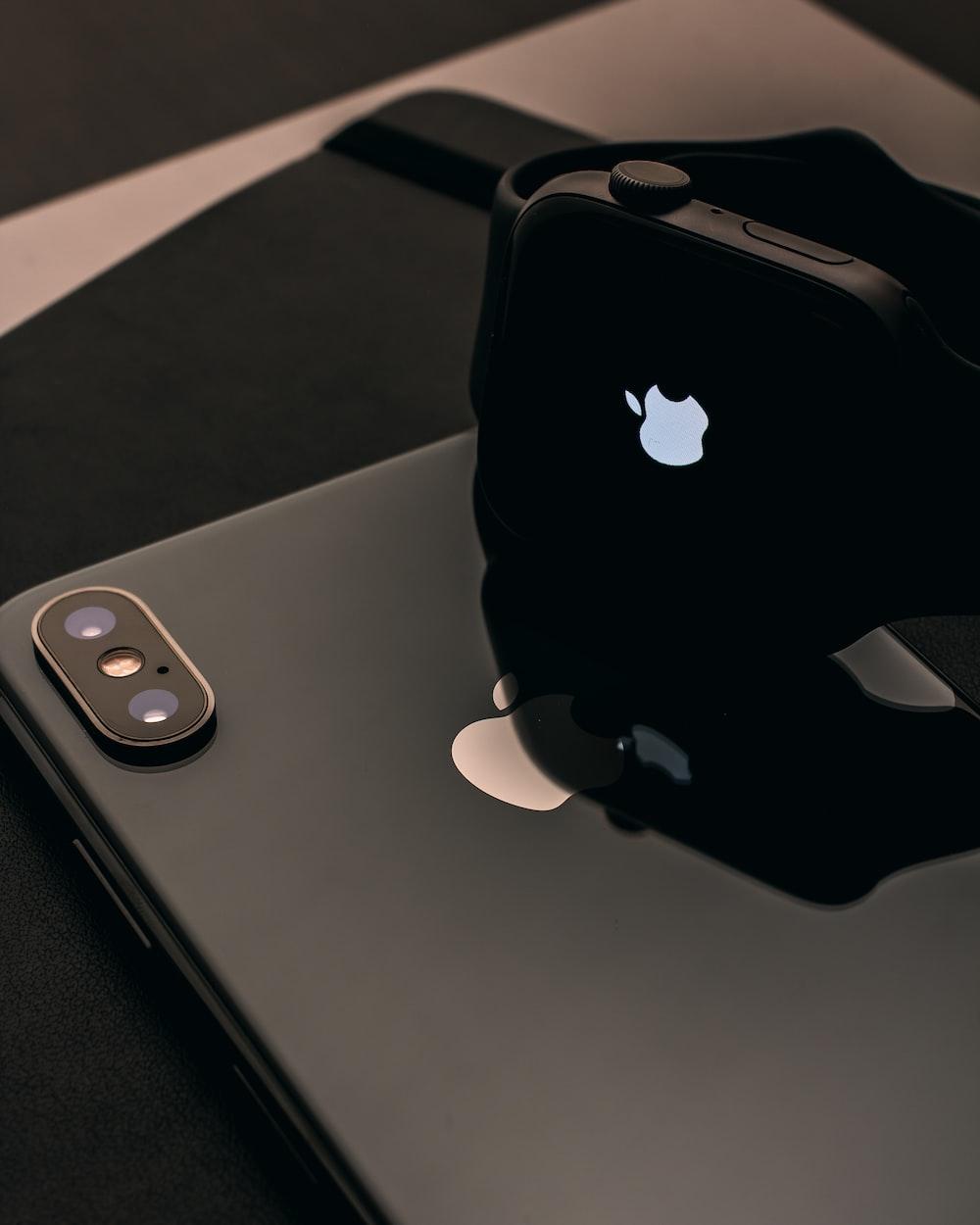 black Apple Watch on iPhone X