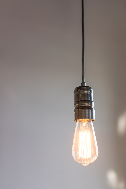turned on gray pendant lamp