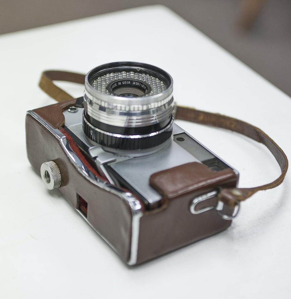 brown and gray mirrorless camera
