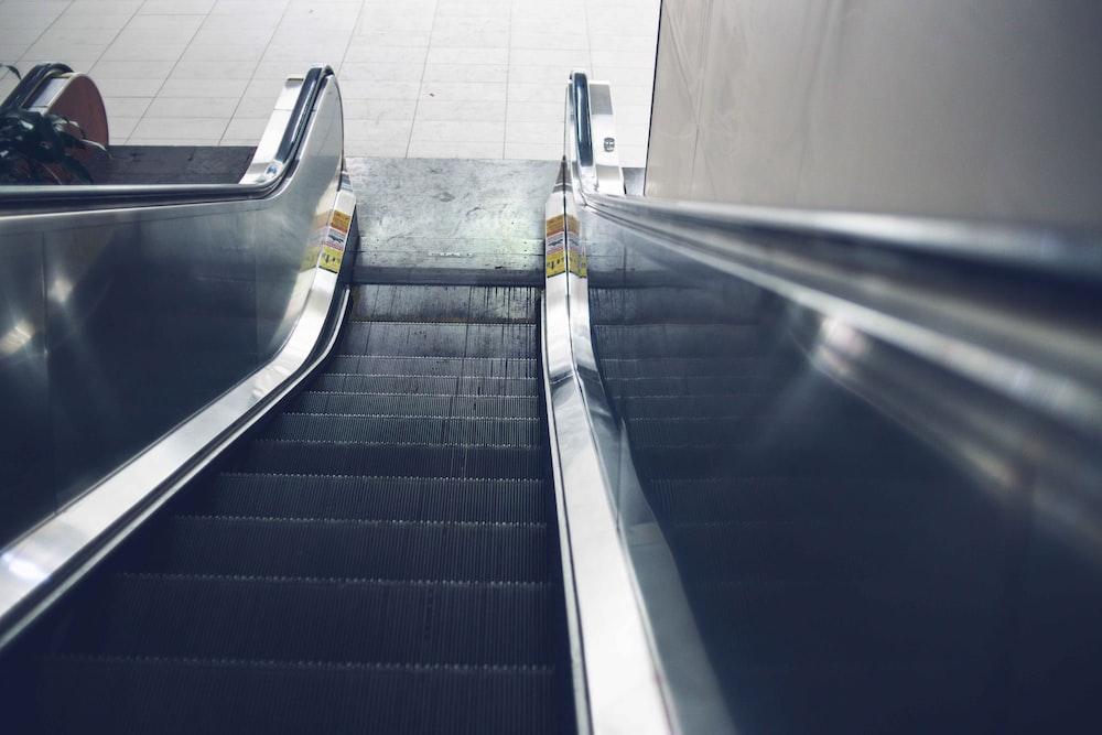 shallow focus photo of escalator