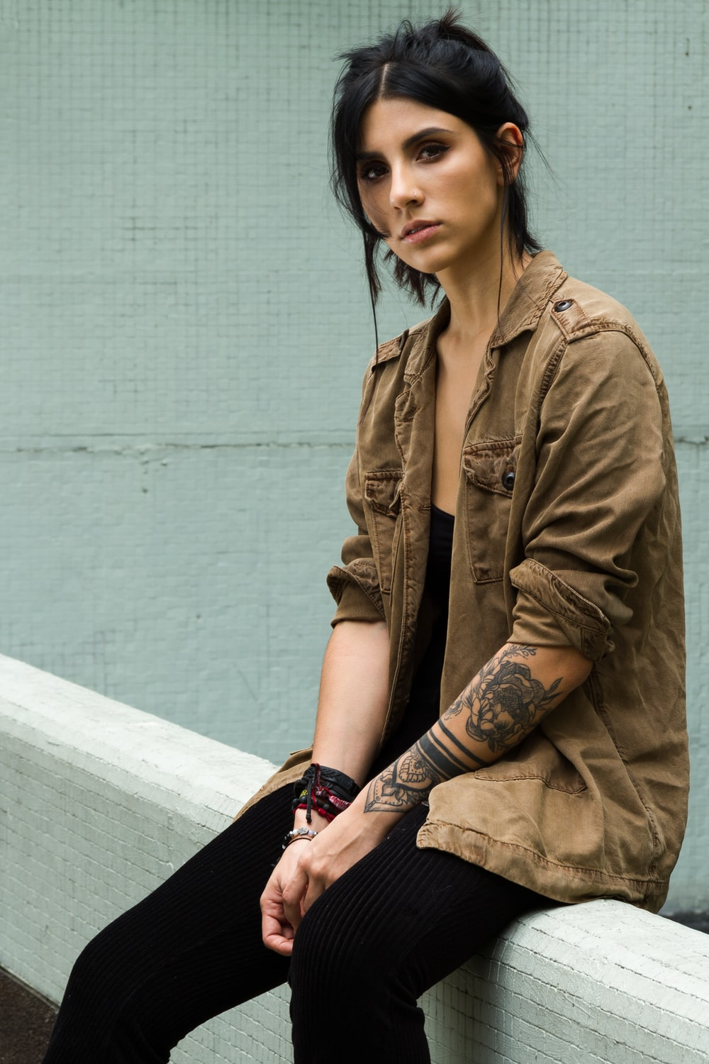 woman in brown button-up long-sleeved shirt
